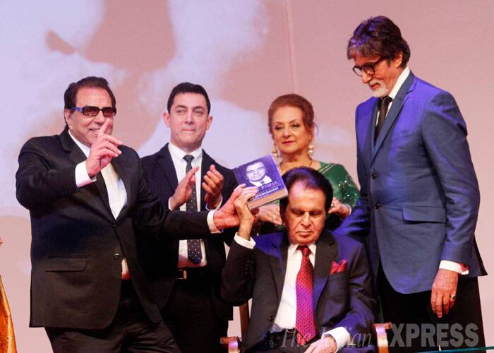 Dharmendra, Aamir Khan and Amitabh Bachchan unveil Dilip Kumar's autobiography. Also seen on stage is Saira Banu. <br /><br /> Penned by author Udaya Tara Nayar, Dilip Kumar's autobiography chronicles the 91-year-old's life from his days as a child to present - the ups and downs in his life, his family, career, wife and more. (Source: Varinder Chawla)
