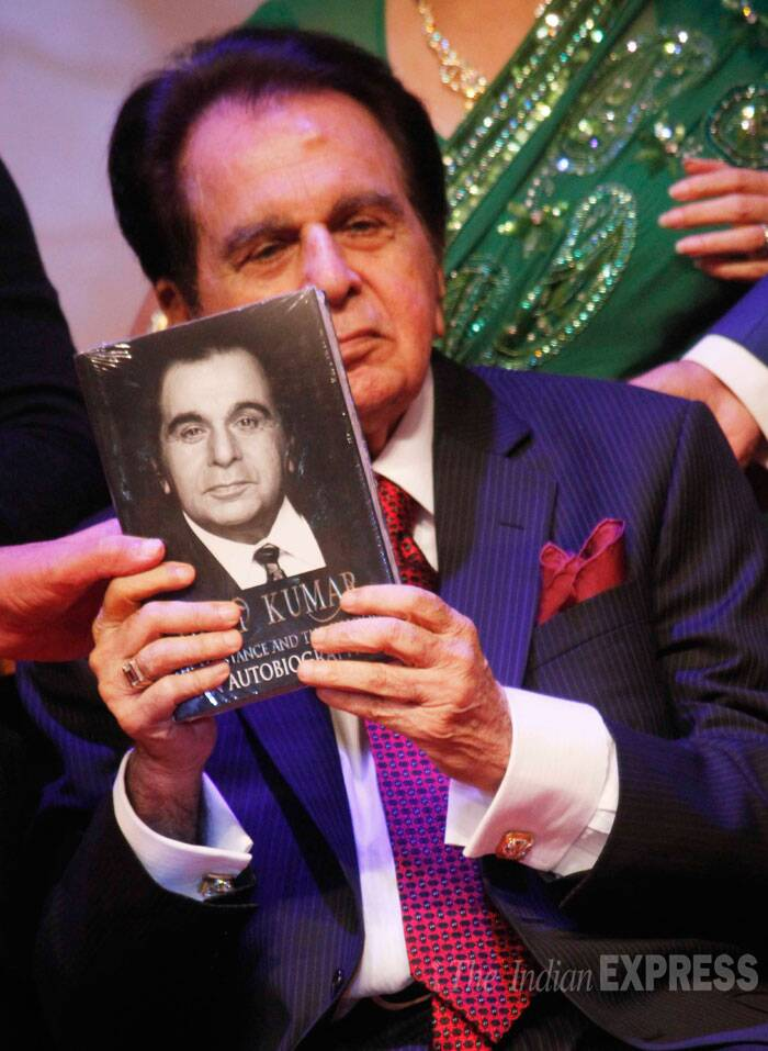 Dilip Kumar holds up his autobiography, 'The Substance And The Shadow' for the cameras. (Source: Varinder Chawla)