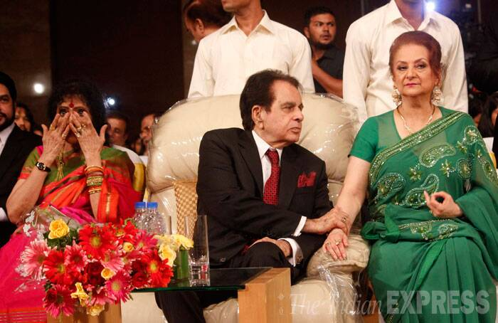 "Dilip Kumar holds on to his wife Saira Banu's arm during the event. ""Please pray that the dedication we have written the book, it is received by the readers in the same way. Every chapter in the book is important and you all will read something that you have not read before about him,"" said Saira. (Source: Varinder Chawla)"