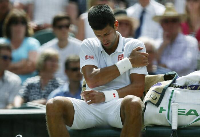 Wimbledon 2014: Novak Djokovic tumbles but does not fumble