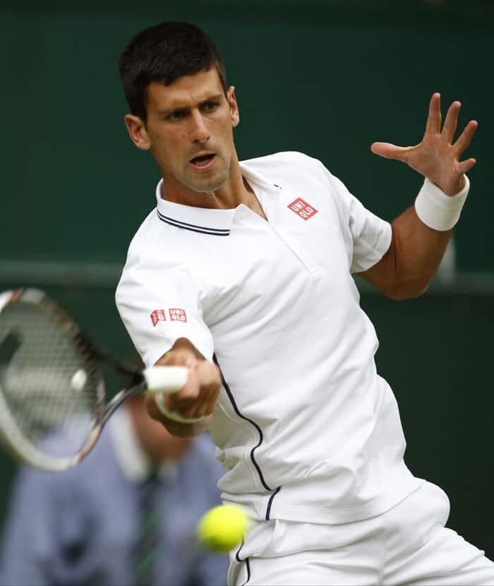 Top seeded Novak Djokovic beat Radek Stepanek 6-4, 6-3, 6-7 (5), 7-6 (5) on Wednesday to reach the third round of Wimbledon. (Source: AP)
