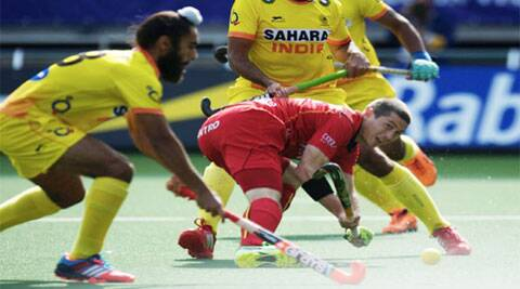 India had held higher ranked Belgium 2-2 until the last minute scrimmage goal from John-John Dohmen (in red). (Source: Hockey India)