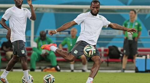 Ivory Coast's Didier Drogba, right, practices during a training session ahead of their World Cup opener against Japan on Saturday. (Source: AP)