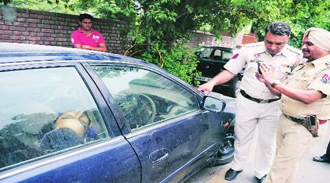 Police with the car outside SCD Govt College in Ludhiana on Sunday.( Source: Express photo by Gurmeet Singh)