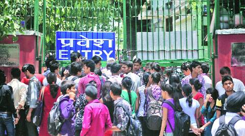Students outside School of Open Learning (above) and at Daulat Ram College on Tuesday.Oinam Anand