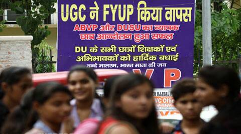 ABVP students on Monday celebrate the UGC directive to Delhi University that FYUP be scrapped. (Source: IE photo by Ravi Kanojia)