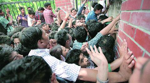 The rush for forms at Daulat Ram College on Monday.