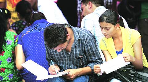 Students fill forms at North Campus on Monday. Colleges cited inflation as reason to increase the fees. (Source: Express photo by Ravi Kanojia)