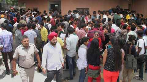 Students rush at various form counters at a college in New Delhi. (Source: PTI photo)