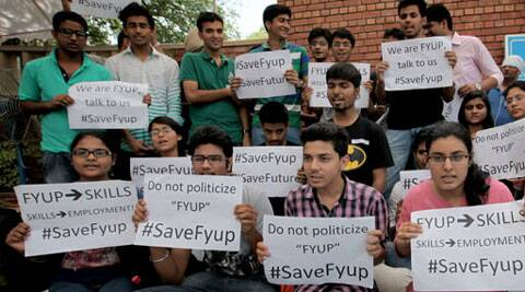 Dinesh Singh reportedly resigned in protest against the UGC's direction to dump the controversial Four Year Undergraduate Programme (FYUP) deepening the crisis ahead of the new academic session.  Students raise slogans in favour of FYUP, near VC office at Delhi university on Tuesday. (Source: Express photo by Ravi Kanojia)