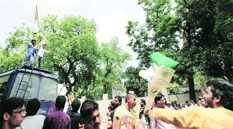 Members of students' unions celebrate FYUP's rollback in North Campus on Friday. (Source: Express photo byRavi Kanojia)