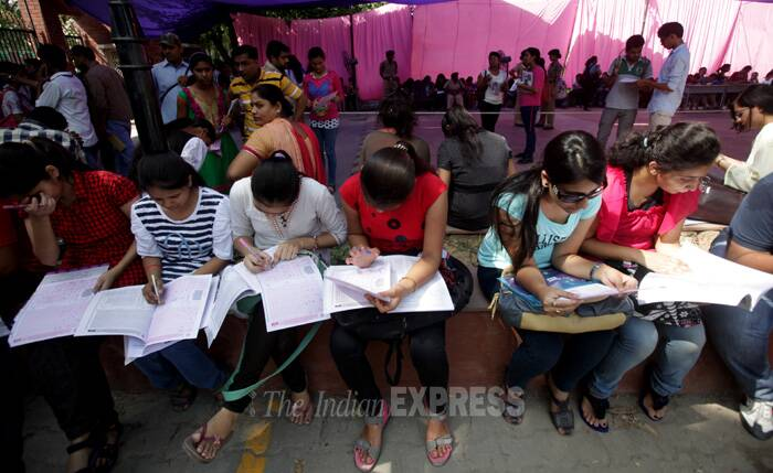 """Most students have already started filling forms, so most of the calls are related to details on form-filling. Questions are related to confirmation of payment receipts, choosing best of four subjects, or ways to rectify mistakes that have been made while filling forms,"" Ashutosh, another volunteer, said. (Source: Express photo by Amit Mehra)"