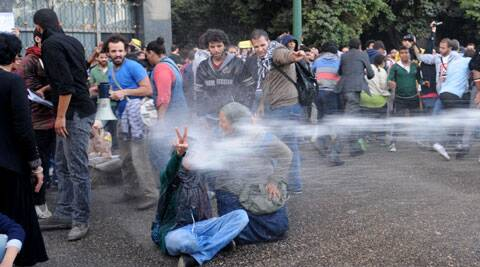 Egyptian police fire water cannons to disperse a protest by secular anti-government activists in Cairo. (Source: AP)