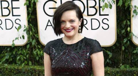 "Elizabeth Moss and Luke Evans will play a ""trouble-making"" couple in the film. (Source: Reuters)"