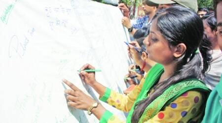 A signature campaign for 'Save Trees' on World Environment Day in Lucknow on Thursday. (Express Photo: Vishal Srivastav)