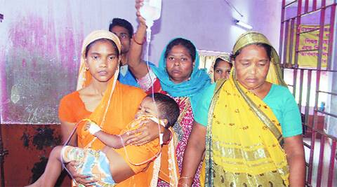 Right: A mother with her child at Malda hospital. Source: Express photo