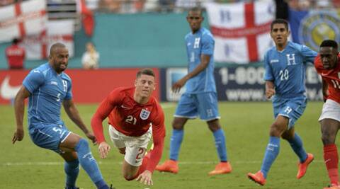 England defender Gary Cahill is tripped by Honduras defender Victor Bernardez during the second half of their friendly match in Miami. (Source: USA Today Sports)