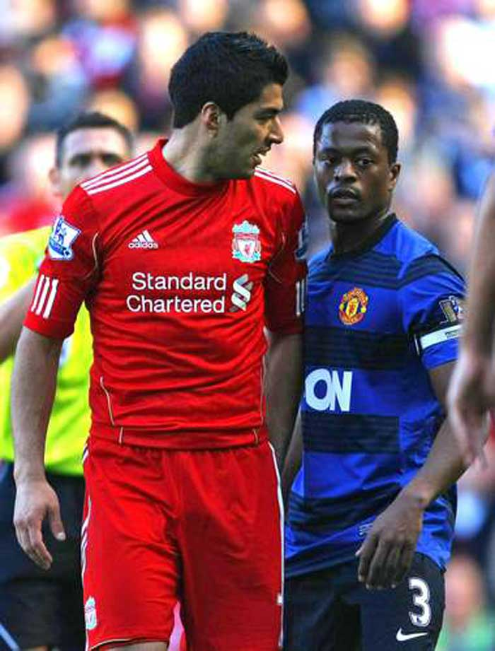 Suarez received a 8 match ban in the EPL for racially abusing Manchester's Patrice Evra. Eariler he had also refused to shake the latter's hand, which is a usual pre-match routine. (Source: AP)