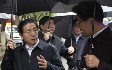 China's Public Security Minister Guo Shengkun, center, talks with Xinjiang Party Secretary Zhang Chunxian. ( Source: AP )