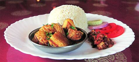 Naga-style pork curry with steamed rice | Source: Partha Paul