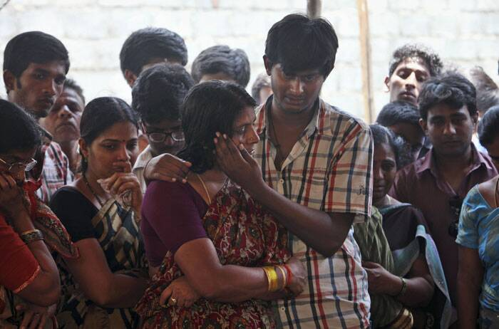 Aishwarya's mother and brother are seen crying during her funeral at her residence in Hyderabad. (Source: AP)