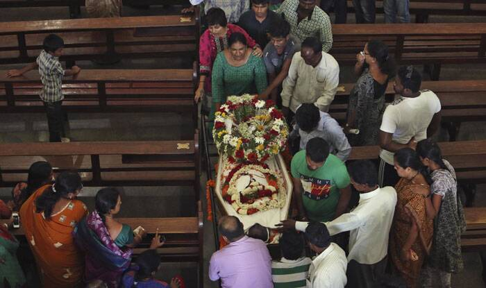 Relatives and friends mourn next to the casket of Devasish Bose during his funeral at St. Joseph Cathedral in Hyderabad. (Source: AP)