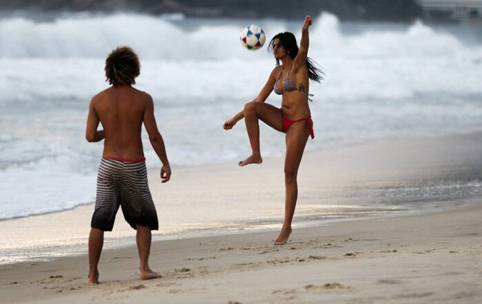 Brazil has always attracted football fans and the country's beaches have fans enjoying the beautiful game. But this time around the fans will think twice before deciding to go sight-seeing. The country Brazil tries to protect its local industries by charging high tariffs on virtually all imported goods. (Source: Reuters)