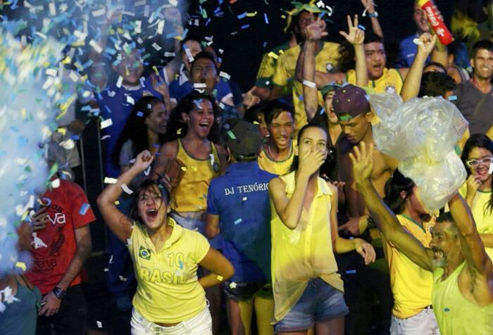 Brazil fans celebrate their team's 3-1 victory over Croatia in the opening game of the World Cup. With this win, Brazil has three points and are at the top of Group A. (Source: Reuters)