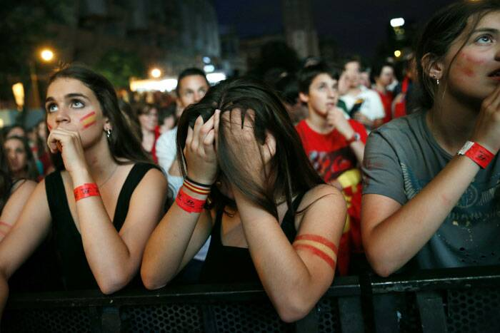 Spain fans could not believe the fate of the defending champions when they trailed Netherlands 3-0, whom they defeated 1-0 in the final of the 2010 World Cup. (Source: Reuters)