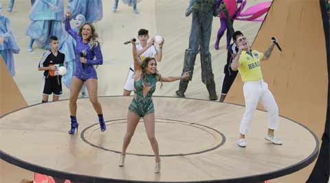 Brazilian singer Claudia Leitte, left, US singer Jennifer Lopez and rapper Pitbull perform during the opening ceremony in the Itaquerao Stadium in Sao Paulo, Brazil. (Source: AP)