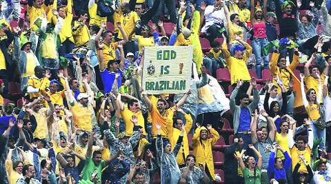 A fan holds aloft a banner during a warmup match between Brazil and Serbia in Sao Paulo on Saturday. REUTERS