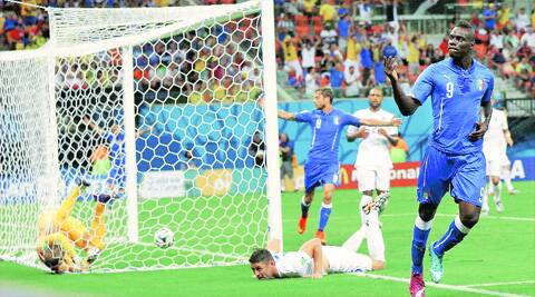 Tumble in the jungle: England goalkeeper Joe Hart and defender Gary Cahill were unable to deny Balotelli. The striker's header proved to be the difference between the two teams. Source: AP