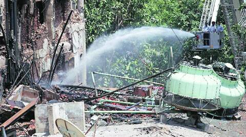 The firefighting in Sector 17, Chandigarh, on Thursday. The buildings, which covered SCOs 4 to 9 and 115 to 127, were closed and cordoned off on Monday.