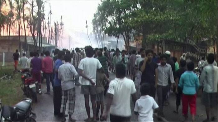 In this image taken from video, people gather on a street in Nagaram village, in Andhra Pradesh after a state-owned gas pipeline exploded Friday. (Source: AP Photo)