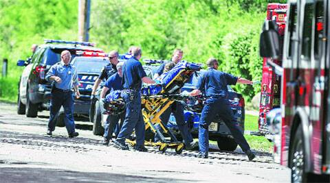 The stabbed girl being rescued on May 31, after she had crawled out of the woods and stopped a biker, pleading for help. (Source: AP)