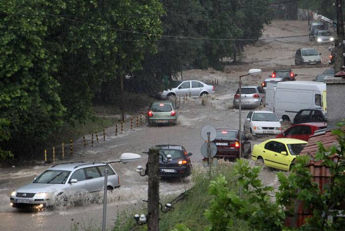 Cars skid in the water in the flooded area of the Black sea town of Varna, Bulgaria. (Source: AP)