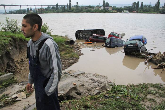 Submerged cars hit by severe flooding are seen in the town of Varna, Bulgaria. (Source: AP)