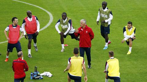 France's coach Dider Deschamps talks to his players during a practice session ahead of the team's opening game against Honduras (Source: Reuters)