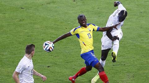 France's Mamadou Sakho (R) kicks the ball next to Ecuador's Enner Valencia (13) (Source: Reuters)