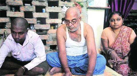 Chanda Babu with one of his daughters, lone surviving son, and the pictures of his three murdered sons at his home in Siwan. (Source: Express Photo byPrashant Ravi)