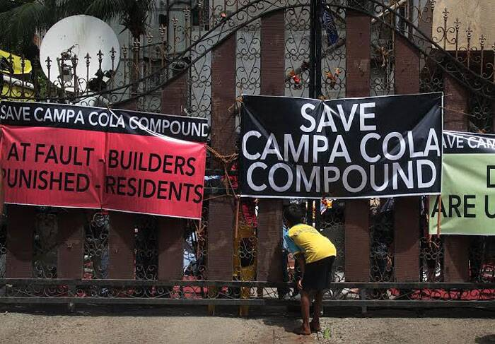 Campa Cola residents thwarted attempts by municipal authorities to cut off essential supplies to the illegal flats, blocking their entry into  the compound.  (Source: Express photo by Amit Chakravarty)