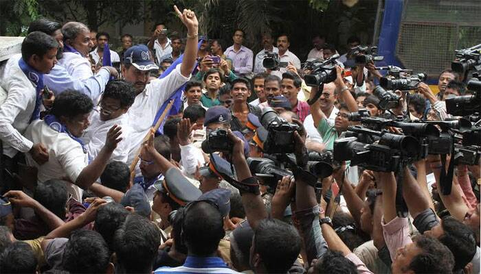 Residents protesting the demolition at Campa Cola Compound on Thursday. (Source: Express photo by Pradeep Kocharekar)