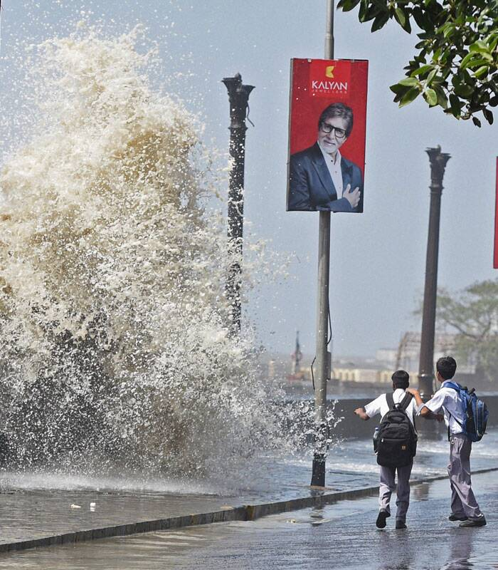 School children enjoy a high tide in Mumbai on Friday. (Source: PTI)