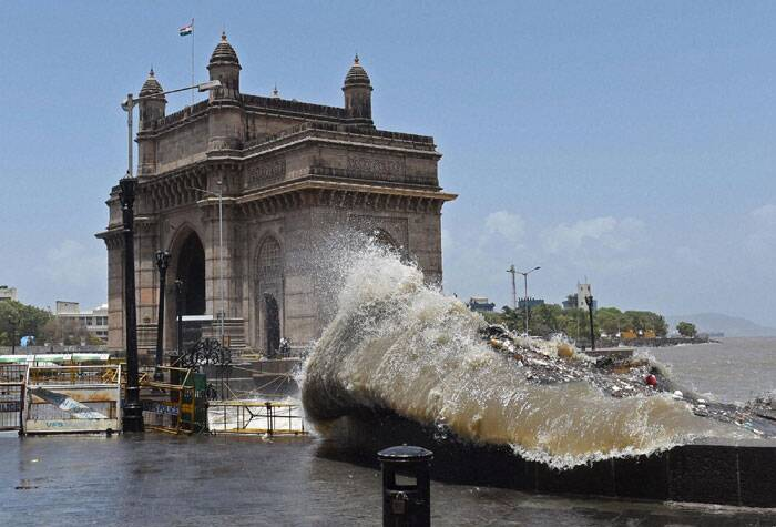 A high tide hits the shore near Gateway of India in Mumbai on Friday. (Source: PTI)
