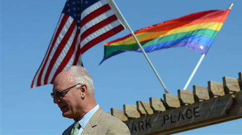 Atlantic City Mayor Don Guardian speaks with the media after raising a flag at Park Place on the Atlantic City boardwalk on Monday, June 16, 2014, in Atlantic City, N.J. Atlantic City is planning a series of events to attract gay tourists, who are becoming an increasingly important part of the resort's growth strategy. Source: AP Photo