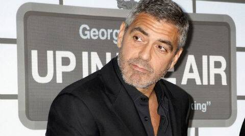 Hollywood heartthrob George Clooney saw off competition from Brad Pitt and Johnny Depp to top a Men Ageing Gracefully list, thanks to his positive disposition and naturally greying hair.