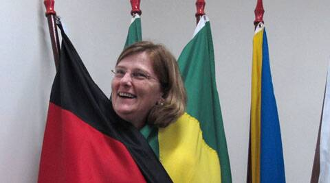 A German-Brazilian drapped in Germany,  Brazil's flag. (Source: AP)