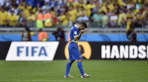 Greece's Giannis Fetfatzidis walks off the field after his team's 3-0 loss to Colombia in their Group C match. (Source: AP)