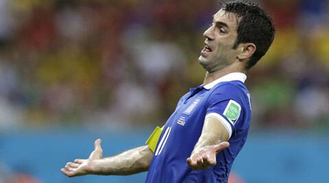 The midfielder said his team would still exit the World Cup with 'our heads high.' (Source: AP)