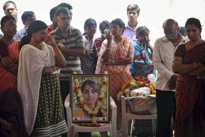 Relatives and friends mourn next to a portrait of Gampala Aishwarya, one of the students who was swept away in a sudden dam release, during her funeral at her residence in Hyderabad. <br /> The students from the southern city of Hyderabad had been taking photographs Sunday evening on the banks of the Himalayan river when they were hit by the rush of water from the Larji hydro power station. (Source: AP)